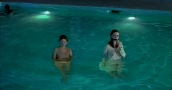 Two Women Fully Clothed In An Apartment Complex Swimming Pool In The Horror Film Shivers