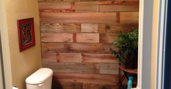 We tore wood off an old fence and nailed it onto our guest for Cheap alternative to stikwood