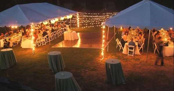Backyard wedding tents, globe lights over dance floor, cocktail tables and guest