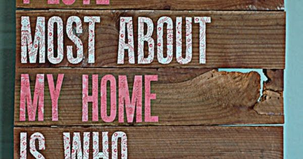 "Wooden sign ... ""What I love most about my home is who"