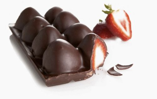 fill an ice cube tray with melted chocolate, add strawberries and chill