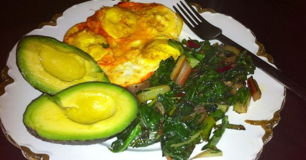 Curried eggs in pastured butter, rainbow chard fried in bacon fat ...