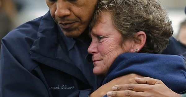 President Obama hugs North Point Marina owner Donna Vanzant as he tours