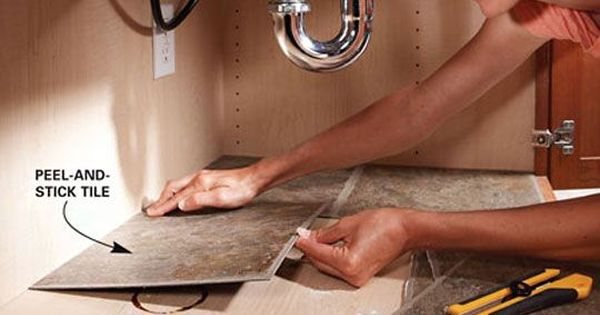 Line your cabinet under the kitchen sink with peel and stick tile.