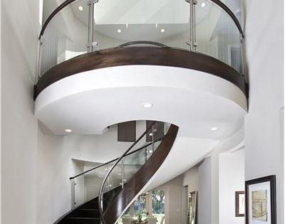 Elegant Contemporary Foyer by Mark English - This dramatic, two-story circular staircase