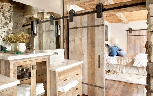 Beautiful Rustic Elegant Master Bathroom with a sliding Barn Door to separate