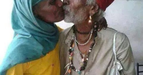 indian old man kissing old woman