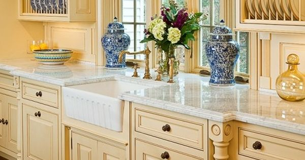 Lovely buttery yellow cream kitchen project idea for Buttery yellow kitchen cabinets