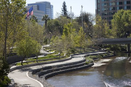 The East Bank Of Guadalupe River Park Provides A Glimpse Of One Of San Jose S Unique Urban Park Settings Photo Urban Landscape Design Linear Park Urban Park
