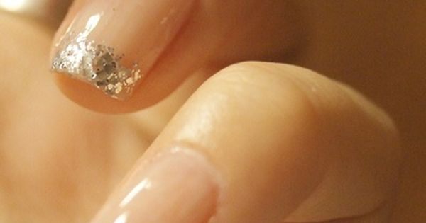 New kind of french manicure: nude nails with silver glitter tips.