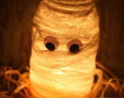 These fun DIY Halloween mason jar luminaries can add a cute decoration