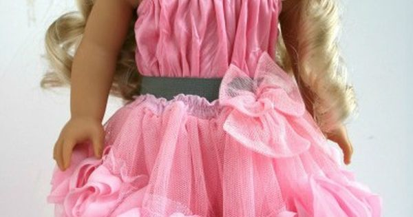 A lovely doll skirt made from a baby dress. There's a link