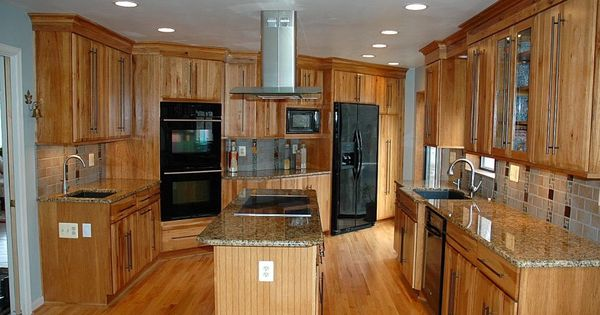 Custom hood over island cooktop hickory kitchen cabinets - Kitchen island with cooktop and prep sink ...