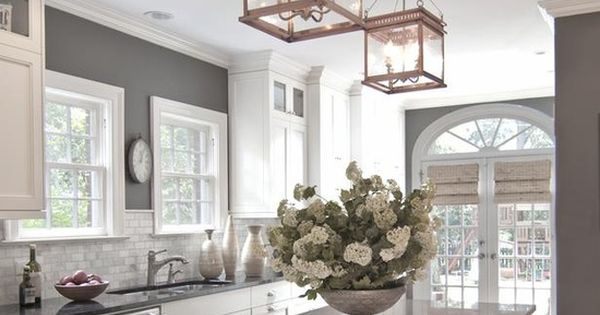[] gray wall color, tall white cabinets, recessed lighting and pendant light