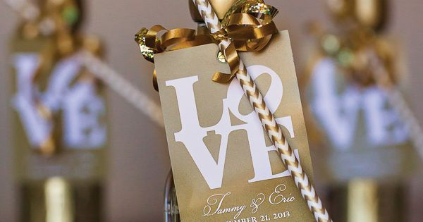 Mini champagne bottles with chevron straws. Cute for a bridal shower favor