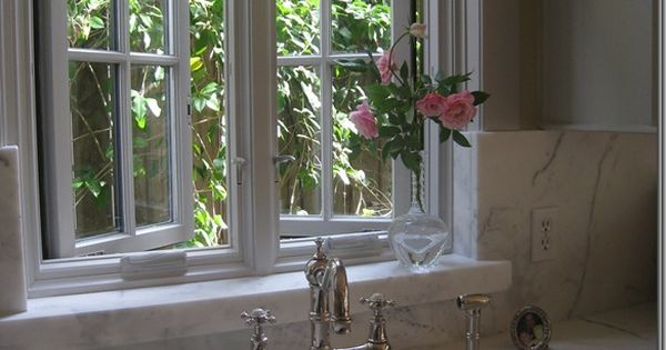 casement windows also like the faucet   marble kitchen