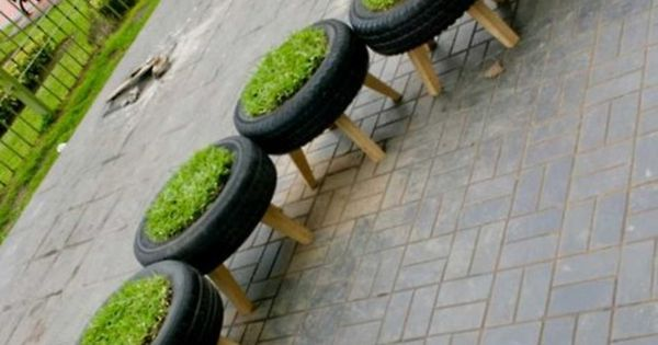 Great Idea for Garden Chairs - tire planter chairs!