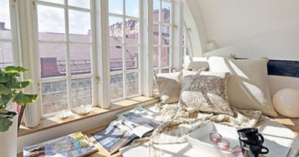 windowseat with a lot of cushions + natural light