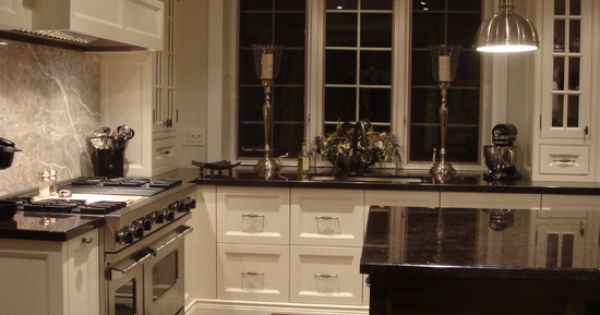Kitchen hardwood black granite white trim design for Cream kitchen cabinets with white trim