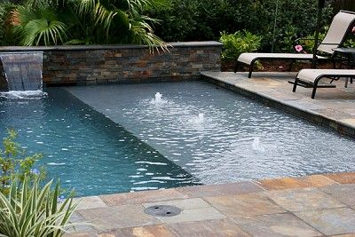 Love the waterfall and tanning ledge this is a favorite for Pool design with tanning ledge