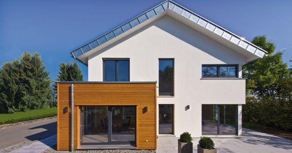 Moderne häuser satteldach holz  Fertighaus mit Satteldach und Erker aus Holz Verschalung | Anbau ...