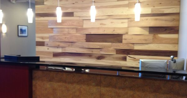 Reclaimed wood wall featured for a Reception desk. Designed by {lid} Chicago.   {lid} Chicago ...