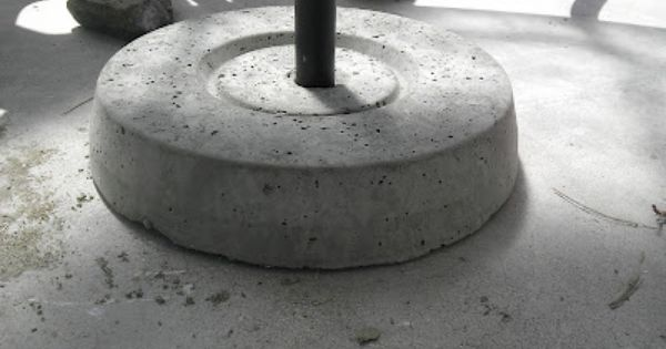 Christina And Ted Buy A House Diy Concrete Umbrella Stand Patio Umbrella Stand Outdoor Umbrella Stand Umbrella Stand