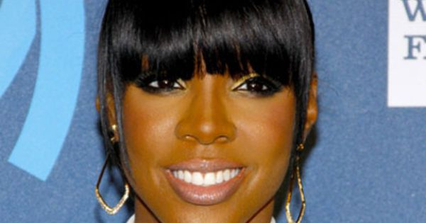 Black Hairstyles 2014: High Unkempt Knot With Bangs
