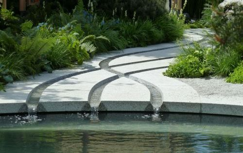 Criss crossing rills, sculpted in granite slabs