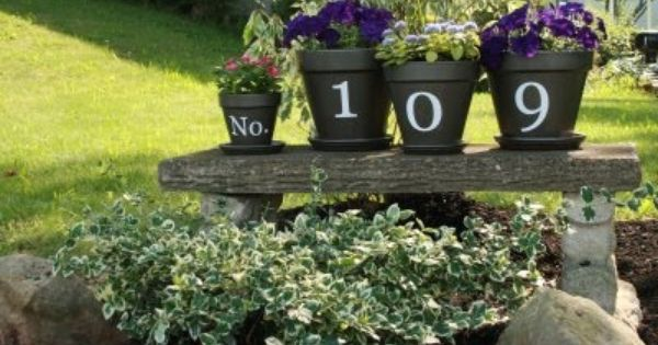 House number flower pots for front porch. Cute idea.