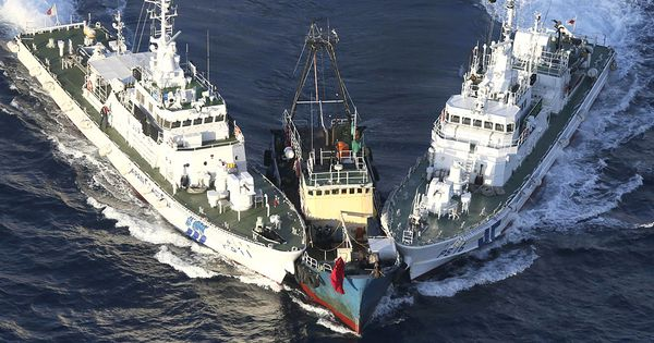 8/15/2012 Japanese coast guard vessels block a protest boat Wednesday after activists