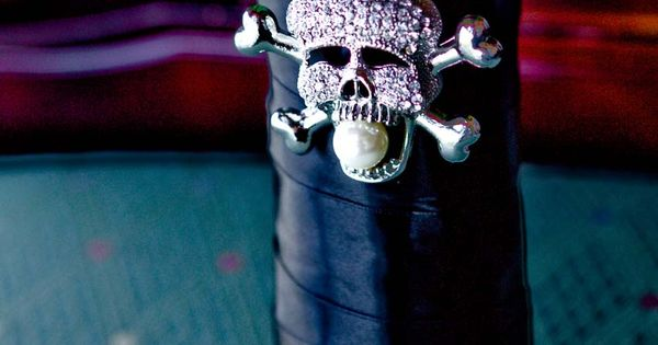 Halloween wedding bouquet with skull jewel.