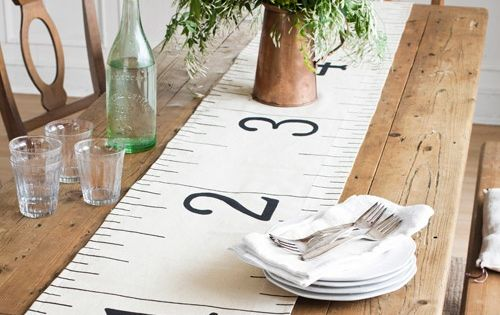 Enlarged tape measure table runner made from fabric drop cloth printed with