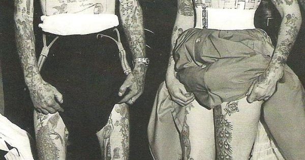 Black and white vintage photo. tattooed couple.