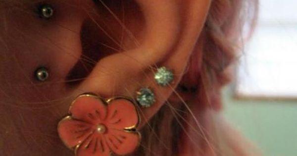 ear piercings.. Love the double tragus!!