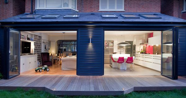 Architectural Design Extension With Open Windows Decking Lounge And Modern White Kitchen Interior Exterior Dusk No People And Pink Cha House Extensions Kitchen Diner Extension Bungalow Extensions