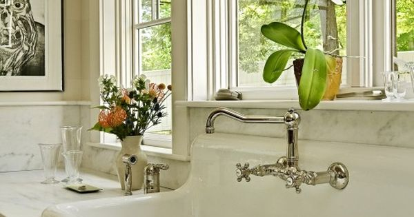 Towel Rack in front of the kitchen sink and windows