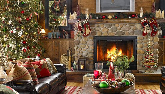 Decorate for the holidays around a tv over a mantel. Objects are