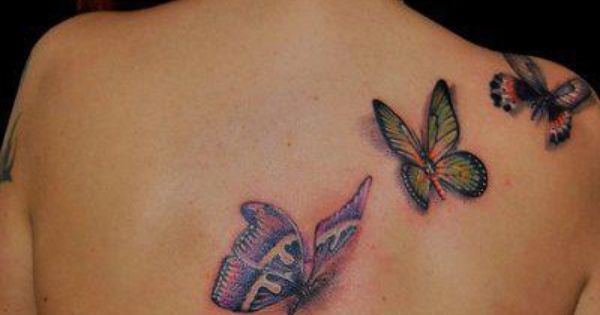 Cool butterflies tattooed on the back of this lady. tattoo tattoos ink