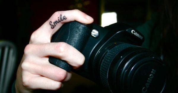 smile tattoo, finger tattoo, word tattoo, phrase tattoo, quote tattoo, body art,