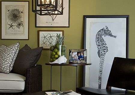 love the prints and the green wall color!