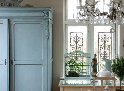 Neutral putty color for kitchen walls, white trim, blue cabinets, white china