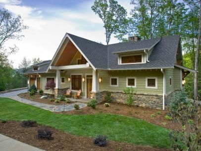 Craftsman Style Home With Green Siding And Stone Pathway Ranch