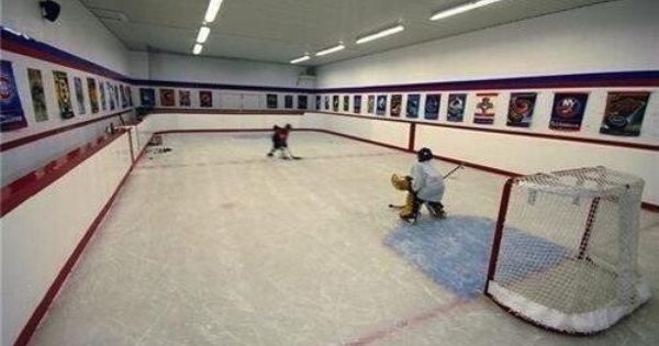 Dull canadian house stocked with ice rink and zamboni for Floor zamboni