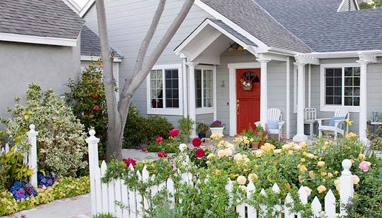 Cottage Garden… white picket fence, grey house, white trim and red door.