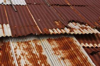 How To Rust Corrugated Metal 12 Steps Ehow Corrugated Tin Barn Tin Corrugated Metal