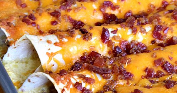 Breakfast Enchiladas ~ Tortillas stuffed with sausage, eggs, cheese and bacon then