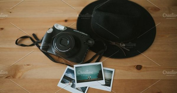 Making Memories, Camera, hat and photos on wooden table