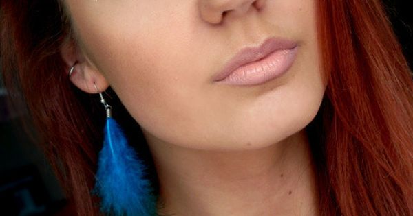 Pretty eye makeup, feather earring, and hair color.