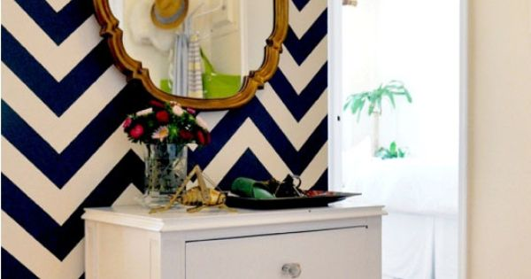 Like the navy chevron pattern on the wall for an entryway with